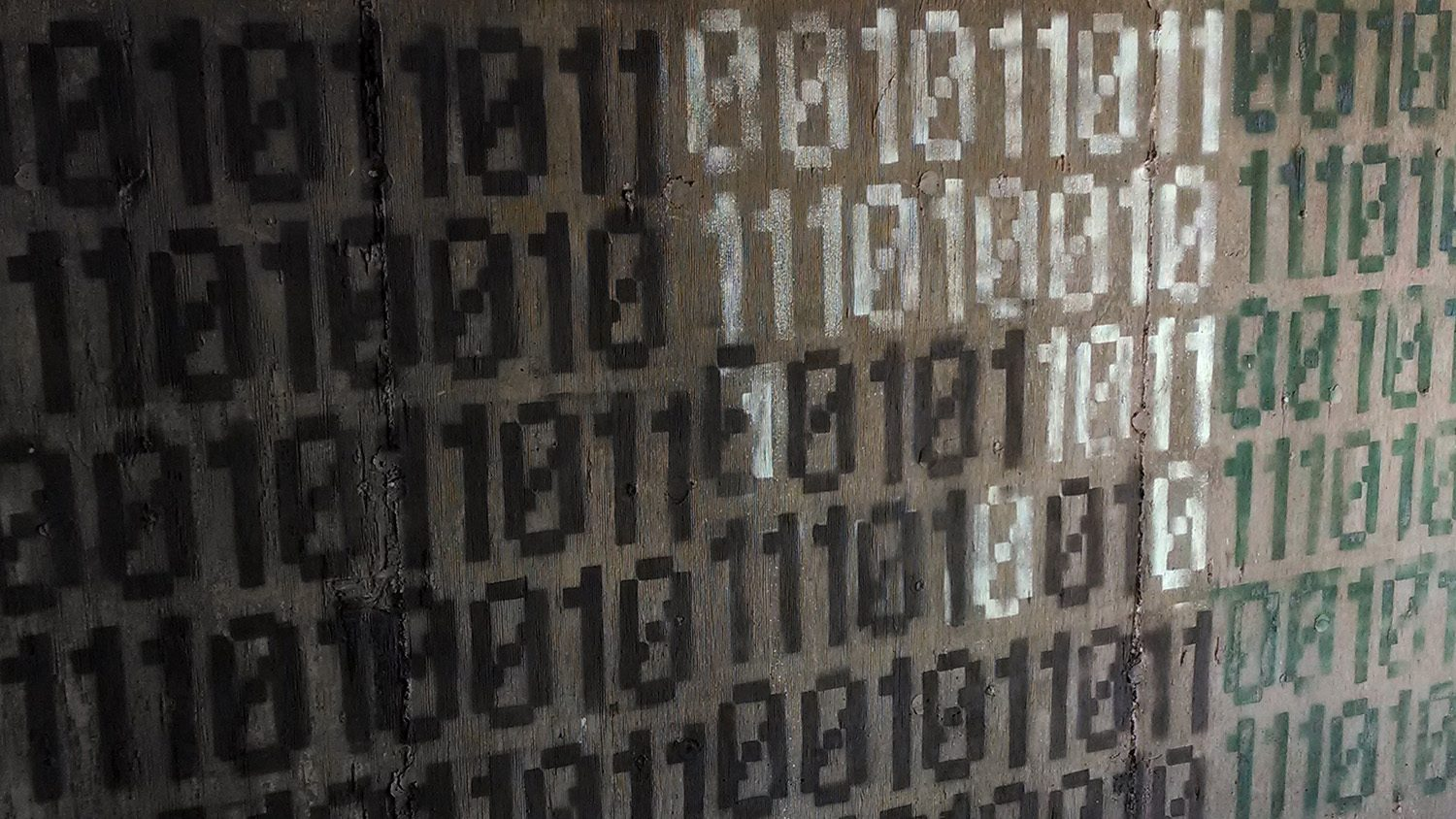 binary code spraypainted on wall