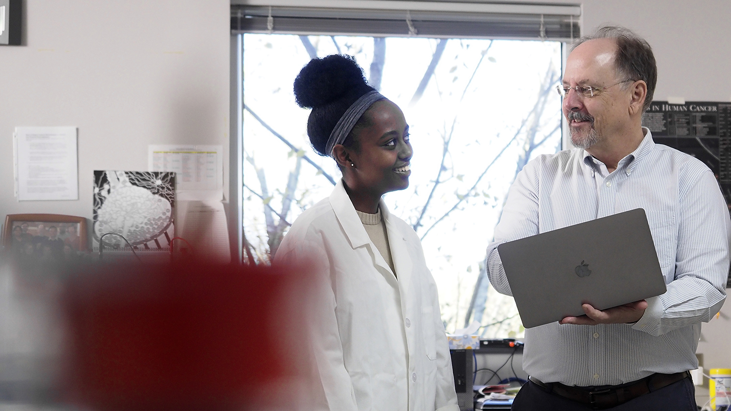 Zoe Lindsey-Mills and Rob Smart talk in his lab